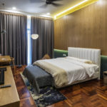 Vista Residences Penthouse Design –Master bedroom feature wall clad in timber panel – Be In Design Solutions Sdn Bhd